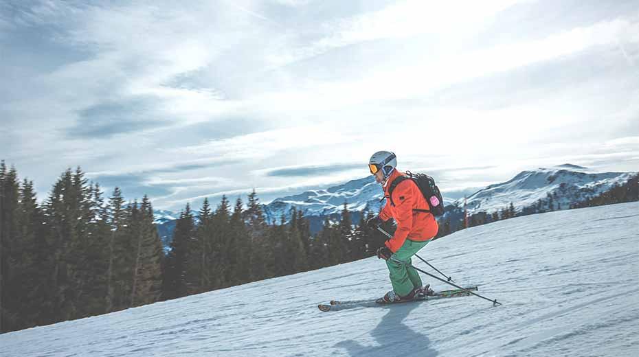 Man skiing downhill and burning calories